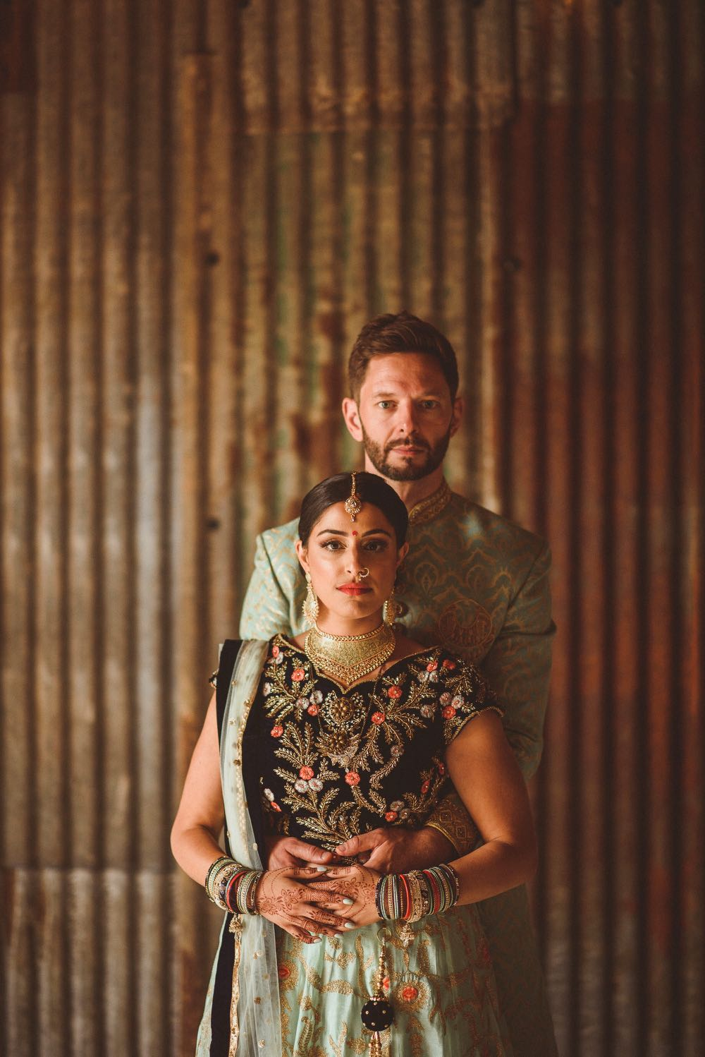 Couple in Indian wedding dress in the Really Rustic Barn