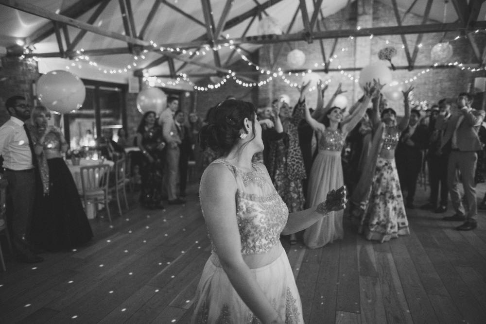 The brode gets ready to toss the bouquet in the Red Brick Barn
