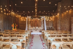 Kejal & Matt ensured they represented both their heritages by having a fabulous fusion rustic Indian country wedding at The Green in Cornwall. This imageos of a mandap set up in the Really Rustic Barn.