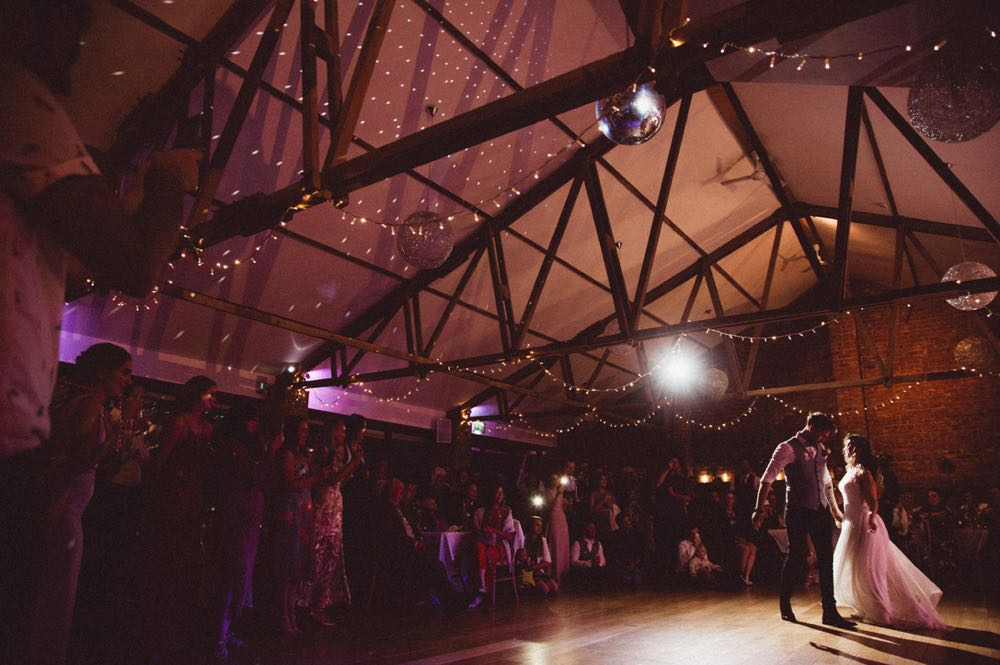 Teh coupel are having their first dance in the Red Brick Barn