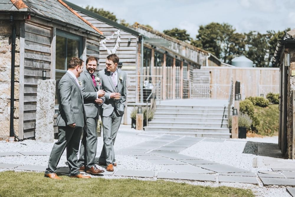 Kieran and his groomsmen sharing a joke before the ceremony
