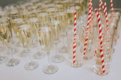 Glasses of bubbles and elderflower fizz set  up ready for guests leaving the ceremony