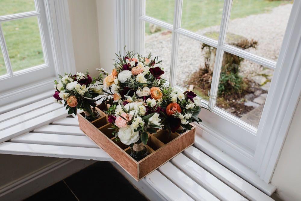 A tray of flowers sitting on a shelf
