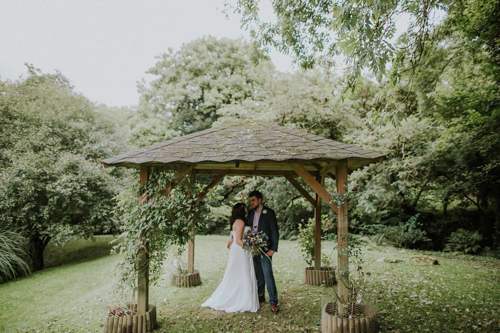 Married couple embracing in a gazebo