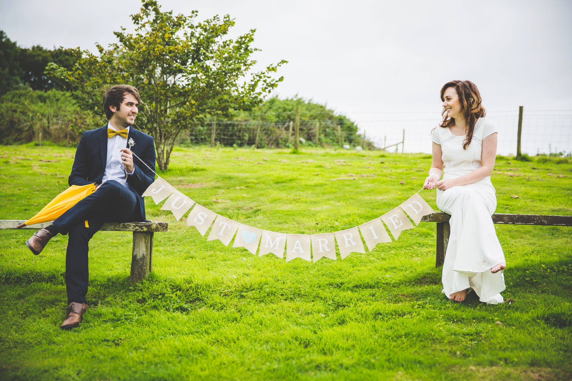 This image shows an elopement couple sitting at the viewing point with a